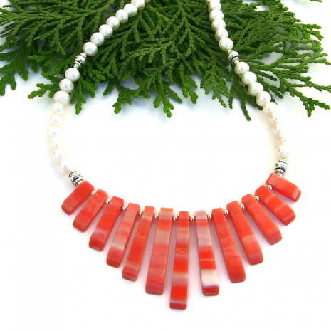 One of a kind orange and white shell fan and pearl necklace.