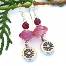 One of a kind handmade earrings featuring Thai fine silver sun charms.