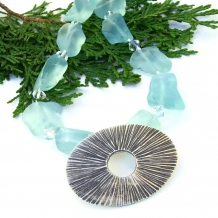Thai Hill Tribes sunburst pendant necklace with aqua recycled glass nuggets.