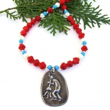 One of a kind Kokopelli pewter pendant necklace with red coral and magnesite.